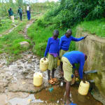 The Water Project: Kapkures Primary School -  Students Fetch Water