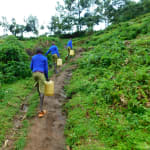 The Water Project: Kapkures Primary School -  Carrying Water Back To School