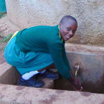 The Water Project: Gemeni Salvation Primary School -  Faith At The Rain Tanks Tap