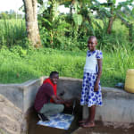The Water Project: Mukhangu Community, Okumu Spring -  Field Officer Ian Nakitare With Lucy
