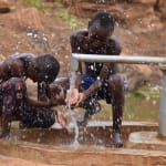 The Water Project: Maluvyu Community E -  Spashing Water From The Well