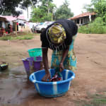The Water Project: DEC Mahera Primary School -  Woman Laundering