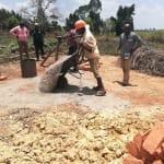 The Water Project: Rubana Yagilewo Community -  Dumping Cement