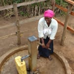 The Water Project: Rubana Yagilewo Community -  Kunihira Roselyne Fills Container With Water