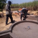 The Water Project: Rubana Yagilewo Community -  Well Pad Cement Dries