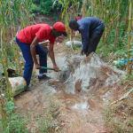 The Water Project: Hirumbi Community, Khalembi Spring -  Mixing Cement