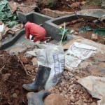 The Water Project: Hirumbi Community, Khalembi Spring -  Tile Setting
