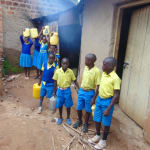 The Water Project: Saride Primary School -  Students Carrying Water