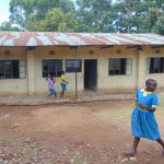 The Water Project: Saride Primary School -  Students Outside Classrooms