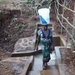 The Water Project: Hirumbi Community, Khalembi Spring -  Carrying Clean Water Home