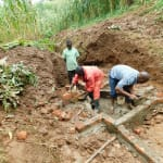 The Water Project: Hirumbi Community, Khalembi Spring -  Brickwork On Spring Foundation