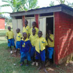 The Water Project: Saride Primary School -  Boys Lined Up At Their Latrines