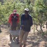 The Water Project: Kala Community C -  Carrying Materials For Construction