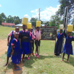 The Water Project: Bulukhombe Primary School -  Students Carrying Water