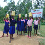 The Water Project: Bulukhombe Primary School -  Students Carrying Water To School