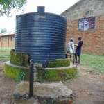 The Water Project: Bulukhombe Primary School -  Small Rain Tank With Broken Tap