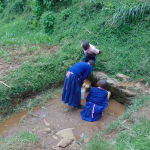 The Water Project: Bulukhombe Primary School -  Students Collecting Water