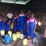 The Water Project: Bulukhombe Primary School -  Students Deliver Water Inside The Kitchen