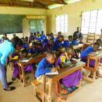The Water Project: Kapkures Primary School -  Students Take Notes During Training