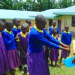 The Water Project: Kapkures Primary School -  Student Demonstrates Handwashing