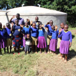 The Water Project: Kapkures Primary School -  Team Leader Catherine Chepkemoi Stands With Pupils And Staff At The Rain Tank