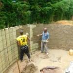 The Water Project: Kapkures Primary School -  Cementing Inside The Rain Tank