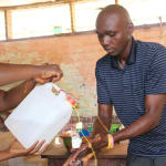 The Water Project: DEC Mahera Primary School -  Handwashing Demonstration Using Tippy Tap