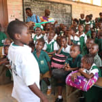 The Water Project: DEC Mahera Primary School -  Student Demonstrates Toothbrushing