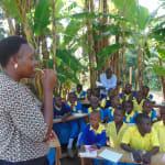 The Water Project: Saride Primary School -  Trainer Karen Maruti Demonstrates Dental Hygiene Using Chewed Stick