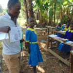The Water Project: Saride Primary School -  Trainer Samuel Simidi And Student Explain Posters
