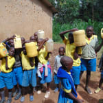 The Water Project: Saride Primary School -  Pupils Bring Water For Construction