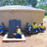 The Water Project: Saride Primary School -  Pupils Posing At The Tank