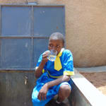 The Water Project: Saride Primary School -  Enjoying A Fresh Drink