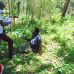 The Water Project: Shiamala Community, David Ashiona Spring -  Handing Out Informational Pamphlets