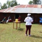 The Water Project: Eluhobe Community, Amadi Spring -  Team Leader Catherine Encouraging The Community Members