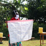 The Water Project: Eluhobe Community, Amadi Spring -  Trainer Shigali Reviews The Prevention Reminders Chart