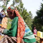 The Water Project: Eluhobe Community, Amadi Spring -  She Was Reading Through The Manual