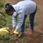 The Water Project: Bukhanga Community, Indangasi Spring -  Trainer Betty Rinses Her Hands