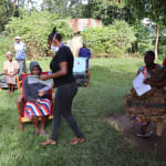 The Water Project: Mukhangu Community, Okumu Spring -  Issuing Pamphlets With Covid Information