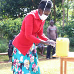 The Water Project: Eluhobe Community, Amadi Spring -  Trainer Shigali Showed The Group The Proper Method
