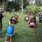 The Water Project: Mukhangu Community, Okumu Spring -  Handwashing Demonstration