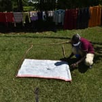 The Water Project: Mkunzulu Community, Museywa Spring -  Improvising A Stand To Hold The Reminder Chart