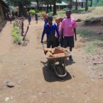 The Water Project: Bulukhombe Primary School -  Students Help Bring Materials To School
