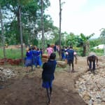 The Water Project: Bulukhombe Primary School -  Students Help Bring Materials To Schoool