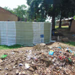 The Water Project: Bulukhombe Primary School -  Sack Knitted Around Tank For Holding The Tanks Plaster