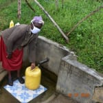 The Water Project: Bukhanga Community, Indangasi Spring -  Josephine Fetches Water From Indangasi Spring