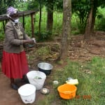 The Water Project: Bukhanga Community, Indangasi Spring -  Josephine Washes Utensils With Water From Indangasi Spring