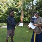 The Water Project: Shitaho Community, Andrea Kong'o Spring -  A Facilitator Explains A Handout To A Participant