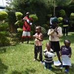 The Water Project: Nyira Community, Ondiek Spring -  Community Members Follow Handwashing Steps
