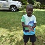 The Water Project: Nyira Community, Ondiek Spring -  Elvis Showing Handwashing Steps